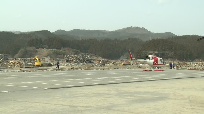 RIKUZENTAKATA, JAPAN - APRIL 1: Helicopter prepares for take off from tsunami disaster zone in Rikuzentakata on April 1, 2011.