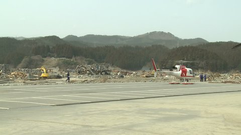RIKUZENTAKATA, JAPAN - APRIL 1: Helicopter prepares for take off from tsunami disaster zone in Rikuzentakata on April 1, 2011.