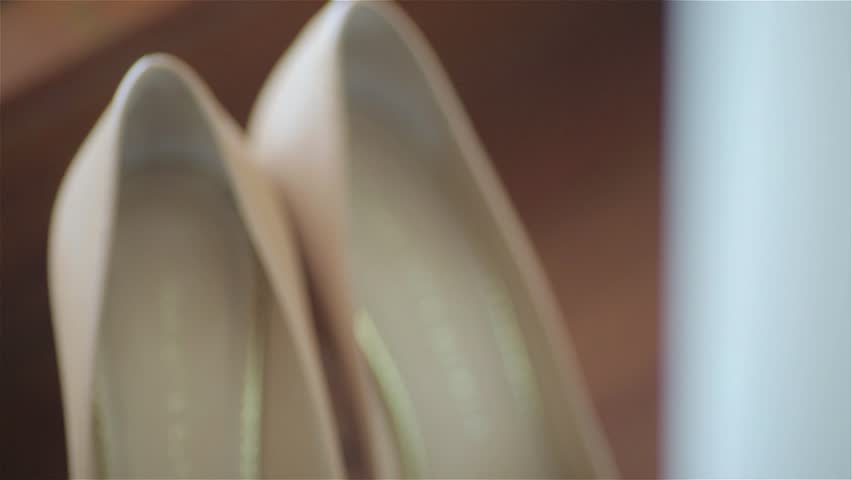 Camera slowly is moving to shoot a pair of classical beige woman's shoes.A concept of Wedding shoes. | Shutterstock HD Video #17536747
