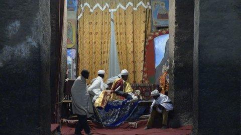 Lalibela, Ethiopia - January 5, 2015: Pilgrims praying in the church of Bete Medhane Alem in Ehtiopia, January 5, 2015.