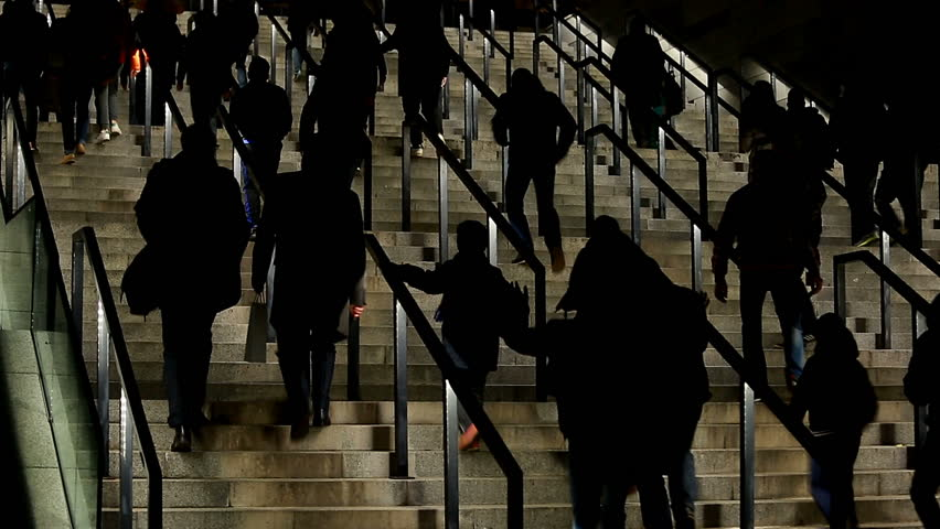 Silhouettes of people walking upstairs, crowd entering sports stadium, tourists