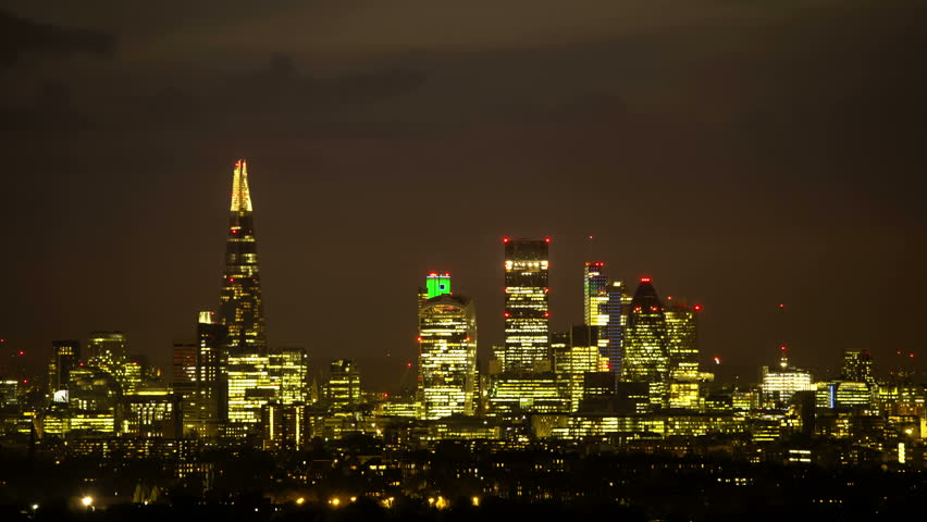 Night to day City Of London Time Lapse Dramatic time lapse of downtown cityscape as the sun rises and the lights go out all over town.