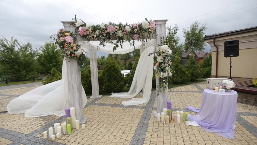 Wedding Arch Decorated With Flowers Before The Ceremony In Sky Background