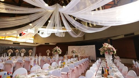 Interior of a wedding hall decoration ready for guests.Beautiful room for ceremonies and weddings.Wedding concept.Luxury stylish wedding reception purple decorations expensive hall
