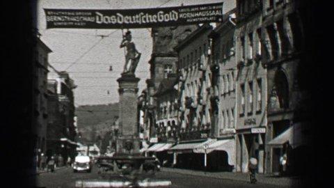 BERLIN, GERMANY 1937: Das Deutsche Gold kornhaussaal münsterplatz German festival city banner sign.