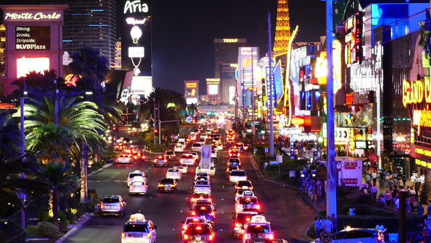Zoom Out - Time Lapse of Busy Las Vegas Boulevard at Night - Circa June 2016