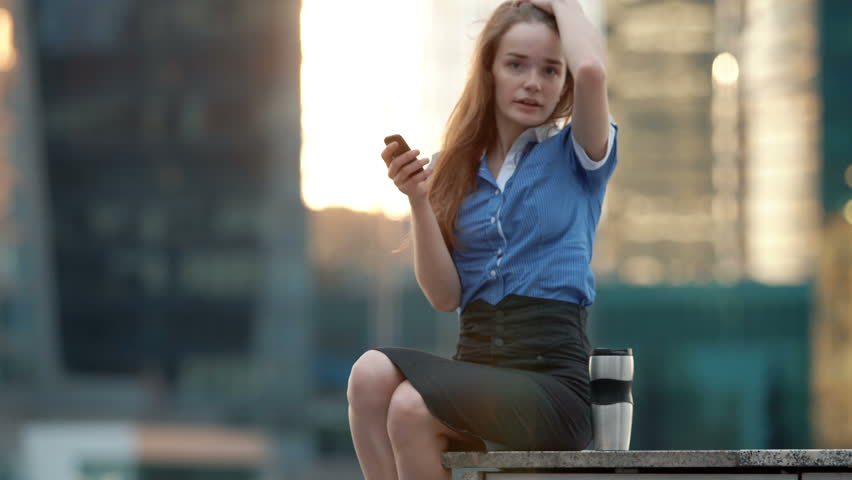 Young happy talking on cellphone in the city   Shutterstock HD Video #17624077