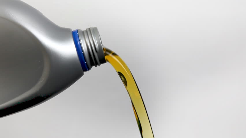 New clean oil pouring out of a can stock footage video for Hd 30 motor oil