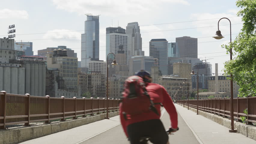 Cyclist Crosses Stone Arch Bridge in Minneapolis Minnesota