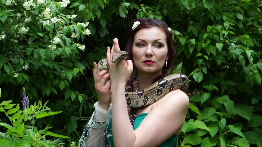 Woman posing with a snake around her neck | Shutterstock HD Video #17670457
