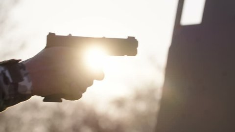 Gun training pistol detail filmed at sunset in native slow motion scene - Slog 3 color science