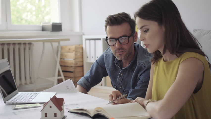 Couple, architects at home planning new house design | Shutterstock HD Video #17710237