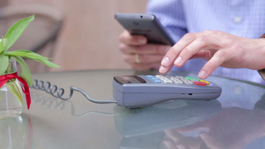 Using the Terminal and the Phone Man is Paying the Price   Shutterstock HD Video #17722957
