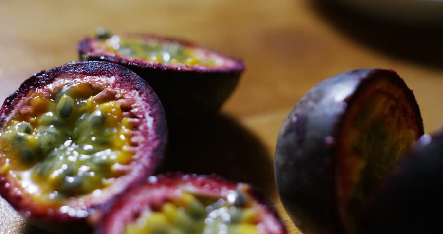 Slow Motion of a rundown on passion fruit, succulent and tasty with a unique taste, unique exotic fruits to the world