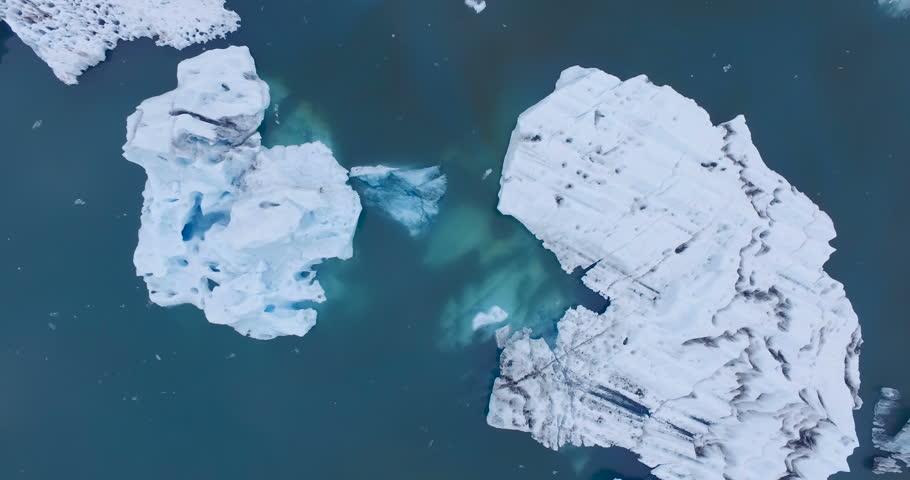 Birds eye view aerial shot of icebergs in water. Jokulsarlon Iceland.