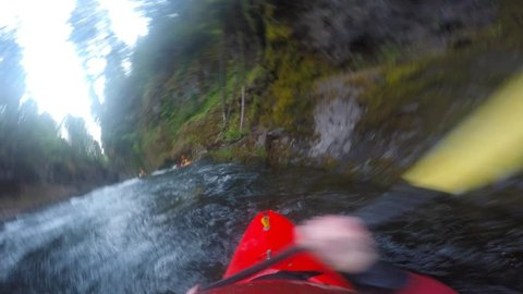 POV of man kayaking Takilma gorge section of the Rogue River in Southern Oregon