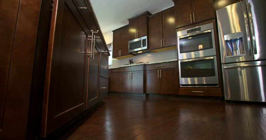 Kitchen Low Angle Reveal Appliances And Cabinets. Camera Slowly Moves Right  To Reveal Kitchen From