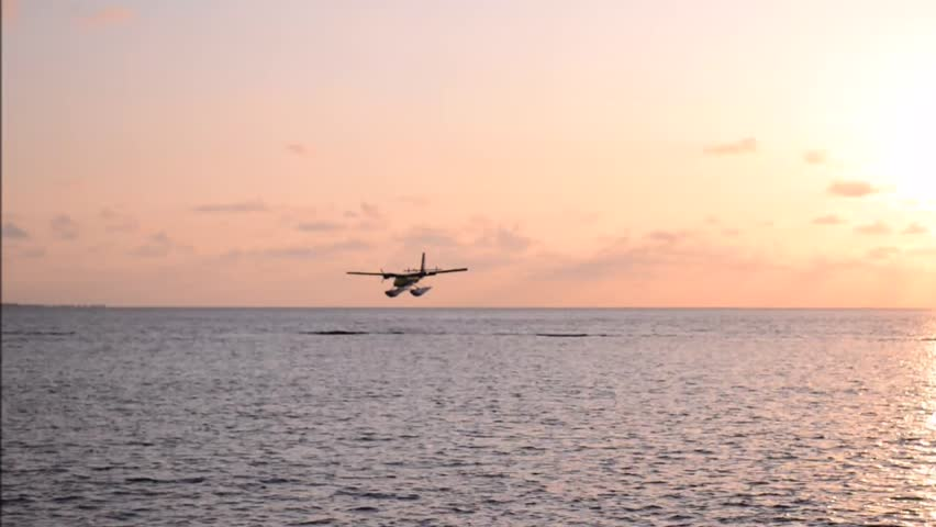 Seaplane flight on the water surface. Indian Ocean. Maldives.