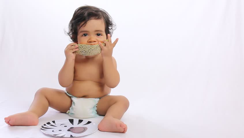 baby eating melon - white background