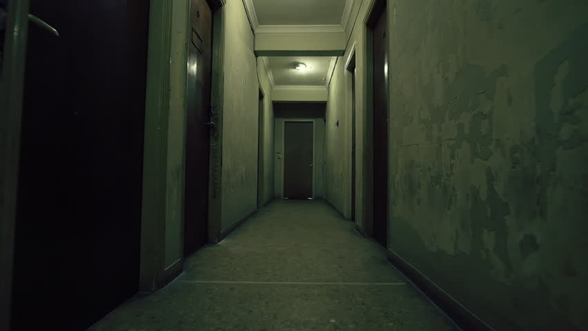 old apartment building long dark hallway tracking stock