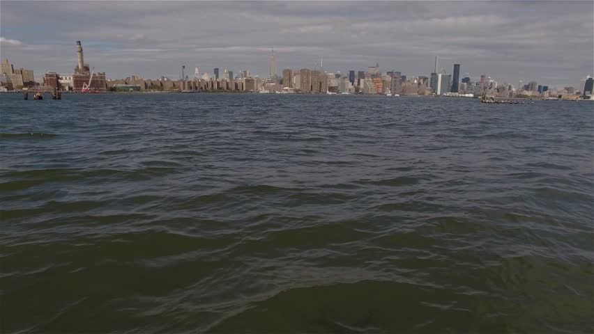 Aerial real time shot of Midtown Manhattan. Camera is approaching to Midtown Manhattan  flying just above the water and later just taking off East River in New York City. | Shutterstock HD Video #17864767