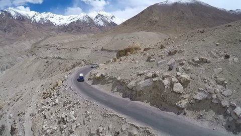 Aerial view of road in Himalayas near Tanglang la Pass - Himalayan mountain pass on the Leh-Manali highway. Ladakh, India.