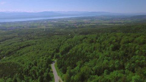 Scenic road in Switzerland aerial shot / Flying over Lake Geneva area