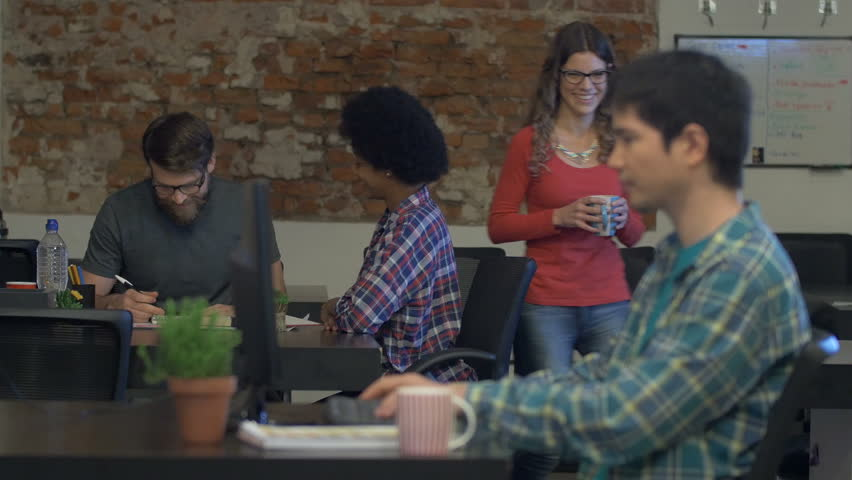 People working office desk drinking coffee talking discussing looking computer screen casual wear mix race businesspeople group | Shutterstock HD Video #17904997