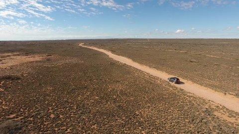 A Toyota Landcruiser Prado Travels on a dirt road in the outback of Western Australia, Gnaraloo, Western Australia