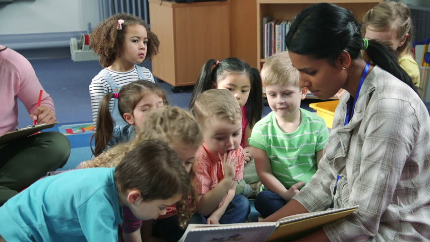 Students interacting with their teacher during story time at nursery. They are sitting on the floor in the classroom. | Shutterstock HD Video #17913607