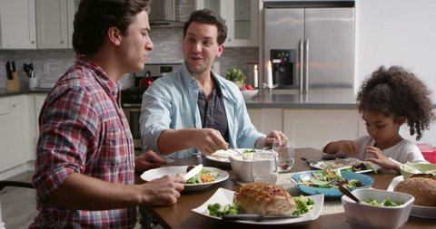 Male couple and their black daughter dining in the kitchen, shot on R3D