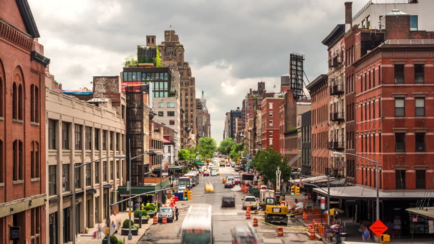 New York City, USA - July 5, 2016: Time lapse view of traffic on the streets of Manhattan's West Side in New York City, United States of America - zoom out.