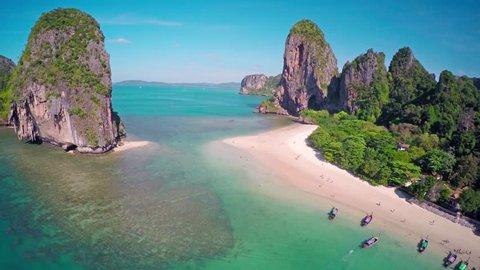 Aerial round 360 degrees view on tropical beach (Pranang beach) and rocks, Krabi, Thailand, 4k