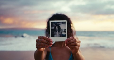Polaroid portrait of beautiful young ethnic woman on the beach at sunset