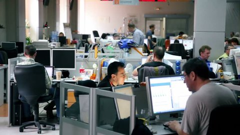 MOSCOW - MAY 6: Several people work in office of Russian Information Agency RIA Novosti - one of major news agencies in Russia, on May 6, 2011 in Moscow, Russia.