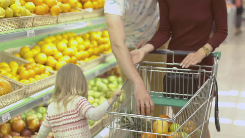 Family makes purchases in the supermarket | Shutterstock HD Video #18026005