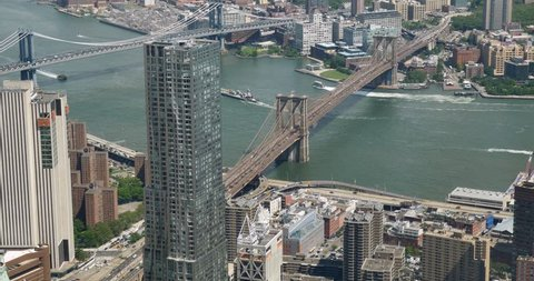 A unique high-angle view of the Brooklyn and Manhattan Bridges over the East River in New York City.