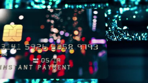 """Bank Card / Instant Payment / Circuit Board. Bank plastic card with caption """"Instant payment"""" flies over circuit board with illuminated electrical signals flowing in electrical conductors. (av28253c)"""