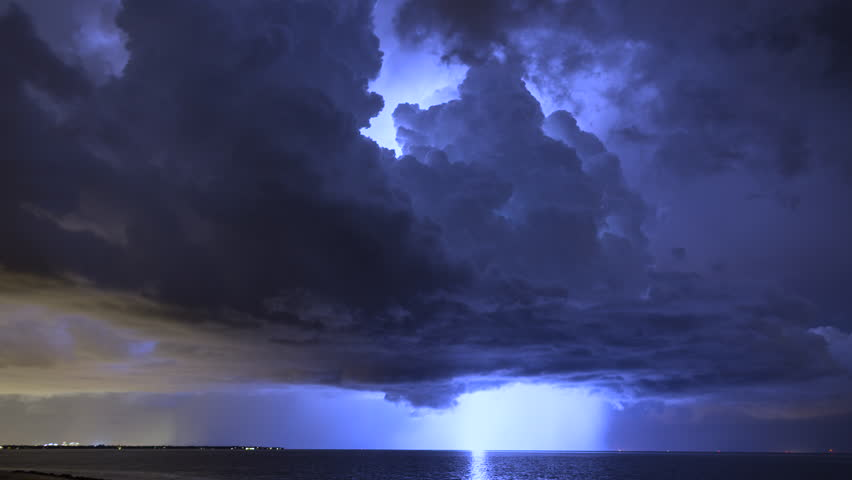 4K UHD - Severe lightning storm time lapse over Tampa Bay Florida waters late at night.