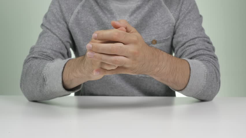 Men showing anxiety by rubbing his hands together