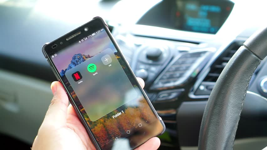 KUALA LUMPUR, MALAYSIA - JULY 9TH, 2016 : Spotify Swedish music service that offers legal streaming music. It provides high quality Audio. User browse trending music sync with Car Bluetooth Audio.