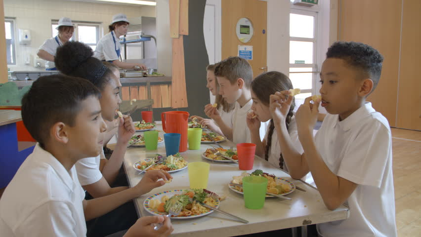 Elementary School Pupils Having Lunch In Canteen Shot On R3D