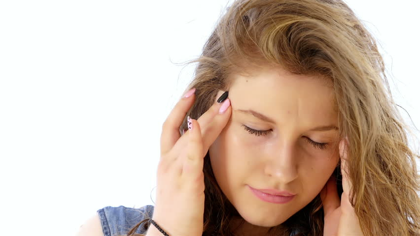 Teenager girl having headache on white background - 4K stock footage clip