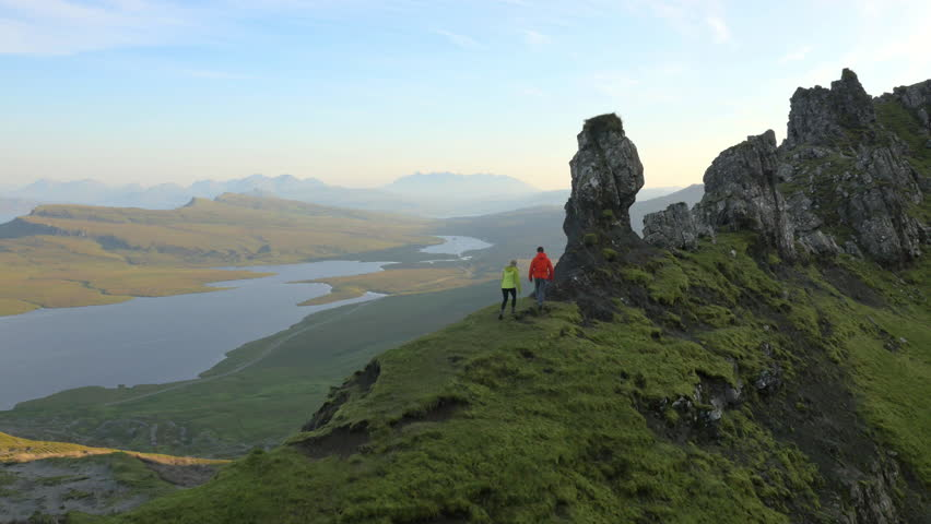Aerial view of couple hill walking Trotternish Ridge Skye Scotland