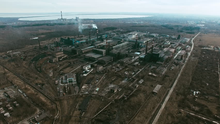 Aerial shot of large metallurgical plant with smoking chimneys polluting air #18320467