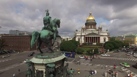 Aerial view of Saint Isaac's Cathedral an downtown of St.Petersburg Russia. Golden domes. Angels. Dramatic sky. Close approach.