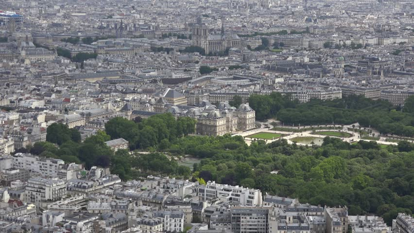 Aerial Shot Luxembourg Garden And Surroundings In Paris, France. Luxembourg Garden was created beginning in 1612. The garden today is owned by the French Senate, which meets in the Palace.