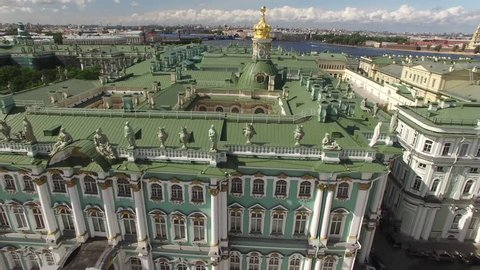 Palace Square from above aerial quadcopter flightover. Best St.Petersburg drone footage. Winter palace hermitage museum fasade. Alexander column with angel and cross. People walking, sunny day.