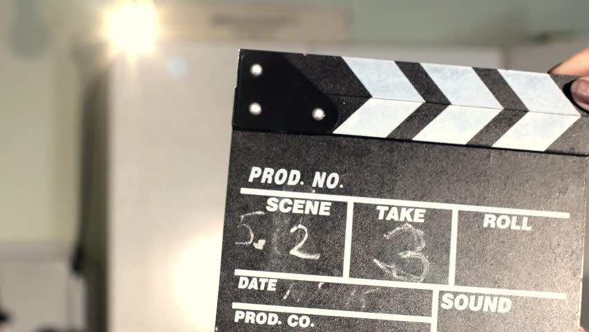 Film slate board being clapped. Slow motion.