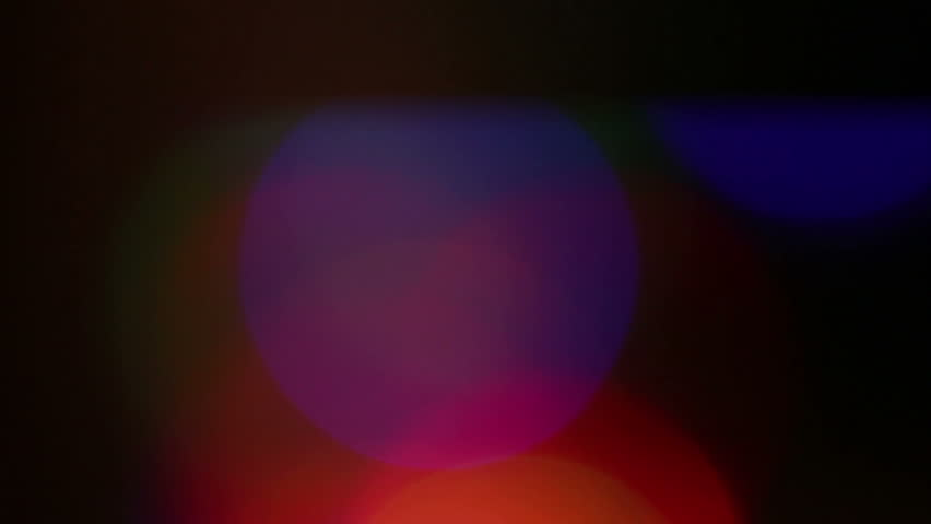 Flashing colored lights. Blurring background.   Shutterstock HD Video #18396427